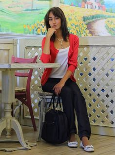 Shop this look on Lookastic:  http://lookastic.com/women/looks/tank-cardigan-jeans-duffle-bag-ballerina-shoes/5193  — White Tank  — Red Cardigan  — Navy Jeans  — Black Canvas Duffle Bag  — White Leather Ballerina Shoes