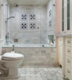 Light Traditional Bathroom by Leslie Lamarre on Home Portfolio The tile on the floor, the tile on the tub surround.