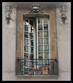 casement window / limestone surround / iron railing