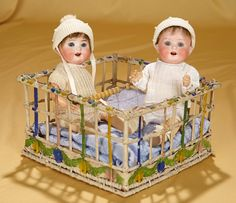 "Pair 9"" All-Original German bisque twins, 300, by Heubach Koppelsdorf in playpen. $500/700"