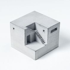 Inspired by the best and most influential concrete architecture of the last century, these miniature concrete homes are designed to advocate and celebrate concretes beauty efficacy and its incalculable contribution to creating and defining spaces in the modern life. Each piece is an individually complete space defined by volumes and voids that give the human imagination a glimpse into what could be lying inside.      Additional information:  Dimensions - Width - 62 mm x Depth - 62 mm x…