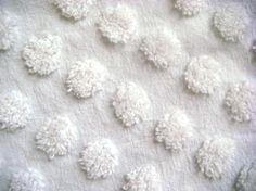 Crib bedding handmade in vintage chenille fabrics.