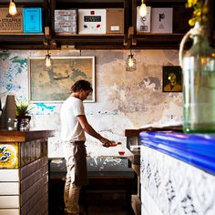 You might be forgiven for thinking they had opened a couple of weeks early, but the relaxed, artfully unfinished décor is the key to the venue's laid-back atmosphere. Helping it along is a patchwork wooden wall with a driftwood look...