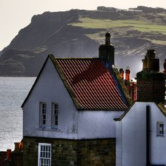 One of the most beautiful places to visit  in England is Robin Hoods Bay.