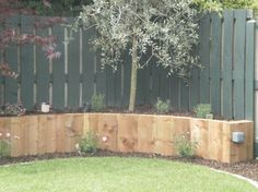 Raised Garden Design on Curved Raised Bed Made Of Reclaimed Brick ...