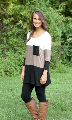 The Pink Lily Boutique - Warm Me Up Black and Mocha Colorblock Tunic , $34.50 (http://www.thepinklilyboutique.com/warm-me-up-black-and-mocha-colorblock-tunic/)