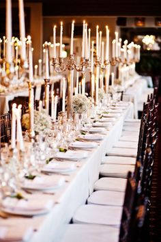 gold candelabras to match chairs with small baby's breath bouquets. soooo pretty!