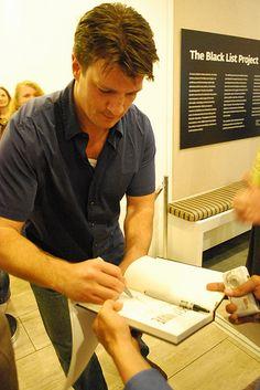 Nathan Fillion signing as Richard Castle.
