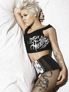 P!nk. One of my girl crushes. I love her strong body and crazy bold in your face music.