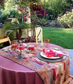 Red table setting in the garden