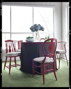 """uniting random chairs into a dining room """"set"""" with paint and new fabric."""