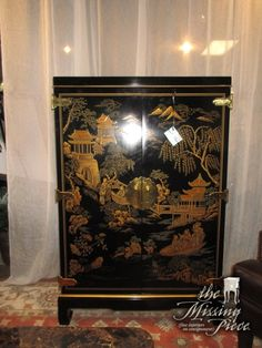 """Drexel Asian style media cabinet in black with gold accents. Inside there is one drawer and space for a TV. Good scale for a bedroom! Only 36""""wide x 22""""deep x 55""""high."""