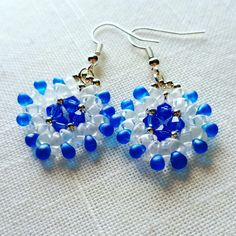 Beautiful bright blue and opaque white swarovski earings. New in our shop. Just made them.