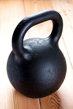 Kettlebells combine cardiovascular, strength, and flexibility training. Try this overhead push press exercise.