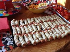 These little Halloween mummies are wrapped sausages in dough .... kids really love them! https://www.youtube.com/watch?v=jIqqMAMqbK8