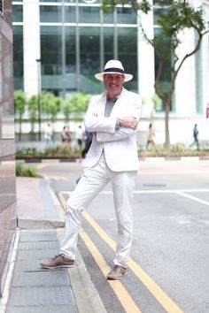 Man In White: Rainer, Works in Finance, Shoes from Zegna, Hat from Porcellino.  #shentonista #theuniform #singapore #fashion #streetstyle #style #ootd #shentonway #men #germany #photographer #armani #dolceandgabbana #dng #ermenegildo #zegna #porcellino