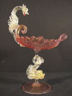 With pink and clear gold fumed glass, a dolphin form figural stem, and leaf form .