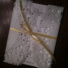 Paper doily Invitations I made for my wedding....so fun and easy to do!