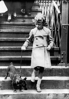 Princess Elizabeth of England takes her dog for a walk. Photograph around 1931. Corgis have been on the scene pretty much from the beginning for Elizabeth II. Over the years she has owned no less than 30 of the little dogs. (Getty Images)