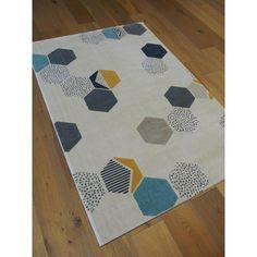 Tapis tendance aux motifs géométriques. Couleurs pastel jaune, bleu et beige. 120x170cm.