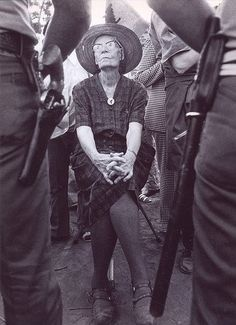 """Dorothy Day (1897 – 1980), prickly as ever and ready for arrest.  A journalist who became a passionate Catholic after a youth of """"free love"""" and experimentation, she was an anarchist, who was led most clearly by radical New Testament teachings. From the 1930s, Day worked closely with Peter Maurin to establish the Catholic Worker Movement, a network of pacifists that worked shoulder-to-shoulder with the poor people they served, blending practical hospitality with direct political action."""