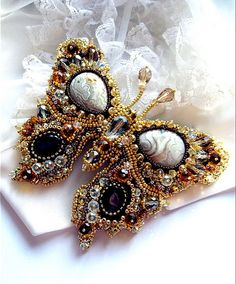Beaded Butterfly by Agija Rezcova - multiple pictures of her work. Very imaganitive!