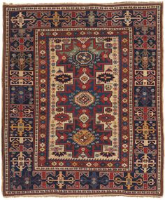 A 140-Year Old Caucasian Lesghi Rug with Rare Ivory Ground and Unique Border Design. Northern Caucasus Mountains, Russia. This Lesghi rug presents atypically wide borders given its diminutive size. Its narrow field highlights an original, sharply drawn rendition of the Lesghi Star, the tribe's signature motif, in triplicate with the color in the uppermost icon evolving out of blue to green. Rare textiles and weavings for sale on CuratorsEye.com
