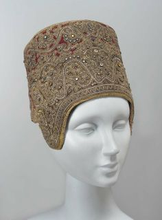 Kaboshnik (woman's cap)   Russia, 19th century   Material: embroidered velvet   Description: red velvet heavily embroidered with silver, gilt-silver yarns, spangles, colored glass; trimmed with gold gimp   Museum of Fine Arts, Boston