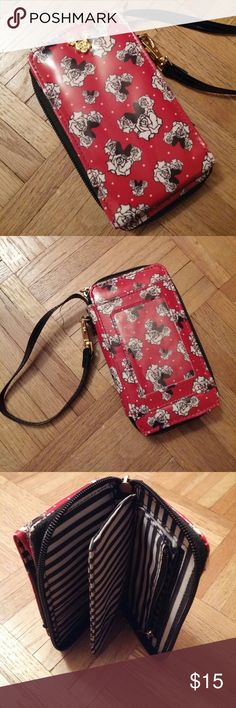 """Disney Parks Authentic Red Minnie Mouse Wallet No trades. Gently used. This minnie mouse wallet has a wrist strap, cell phone pocket, ID holder, & zip closure. The inside has a zip up compartment as well as 9 card slots and another small compartment. Disney Parks Authentic. Measures approximately 6"""" from top to bottom & approximately 3"""" from side to side. Approximately 7"""" side to side with the zipper compartment open. I ship same or next day! Disney Bags Wallets"""