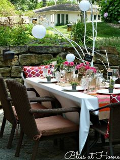 love the branch centerpiece with lanterns hanging, just put some LED lights to take you into the evening...lovely!