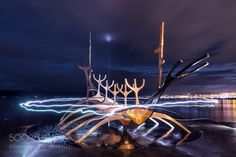 http://500px.com/photo/186167171 Sun Voyager Reykjavik Iceland by drjhnsn -I was in Reykjavik the night of the recent super moon.  The weather had been so bad that I didn't think there would be any chance to actually see the moon so I wasn't even thinking about how I might photograph it.  Came out of the restaurant from dinner and there it was.  A break in the clouds and the super moon was there rising above the horizon.  I quickly got back to my hotel collected all my camera gear and set…