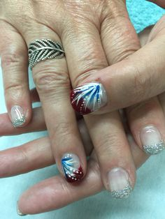 Silver & red glitter French gel nails with patriotic accents. All done with non-toxic and odorless gel.