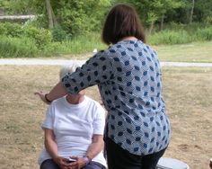 Therapeutic Touch session in a park. An energy healing modality. Paula Neilson, Recognized Therapeutic Touch Practitioner.