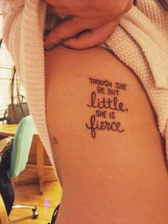 "Side tattoo saying ""Though she be but little, she is fierce"", a quote by Shakespeare."