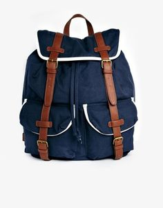 Navy and white leather backpack