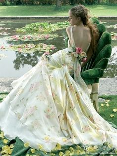 Oh my gosh! Really!?? Yes who made this dress??? I want I need!