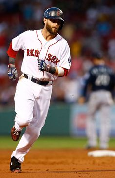 BOSTON, MA - JULY 30: Dustin Pedroia #15 of the Boston Red Sox trots around third base after hitting a two-run home run in the second inning against the Seattle Mariners during the game on July 30, 2013 at Fenway Park in Boston, Massachusetts. (Photo by Jared Wickerham/Getty Images)