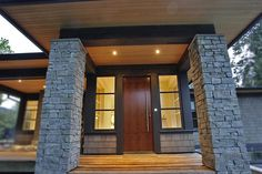 Stunning entrance: rock, shingle, laminate, solid wood door with cool handle. Blackfish Homes and Construction Ltd. Exterior Design, Interior And Exterior, Future House, My House, Residential Windows, Stone Pillars, Wood Doors, Building A House, Entrance