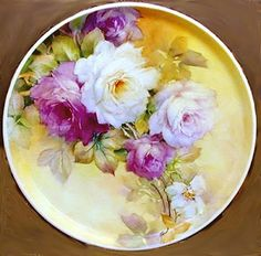 Art by Celeste McCall This is a rose plate which I painted years ago. I think I gave this away or sold it though. A bit stiff looking.needs a good line of opposition to relax the too straight of line caused by the stems. China Plates, Plates And Bowls, Hand Painted Plates, Decorative Plates, Fine Porcelain, Painted Porcelain, China Painting, Ceramics, Craft