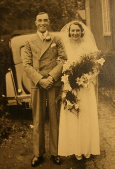 vintage bride and groom-look at the car in the background