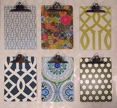 Saw Martha do these, scrap book paper modge poged to cheap clip boards. Hold bills, notes, ect, LOVE!