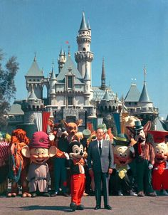 Rare photo of Walt Disney with Disney characters at Disneyland.