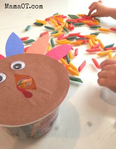 Feed the turkey! 4 creative turkey themed fine motor activities. Includes OT ideas for how to increase or decrease challenge based on age and skill level. #finemotor #thanksgiving #mamaot