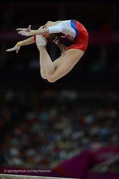Viktoria Komova sheep jump: feet touching forehead ...