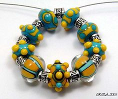 Set 9 Turquoise & Yellow Sunshine  http://www.riveroakacres.com/catalog.php?item=77 lots of pretty Pandora style beads at this site