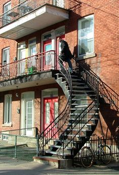 Montreal, Canada, is well-known for its curving outdoor staircases and colorfully painted apartment buildings. Montreal Ville, Montreal Quebec, Quebec City, Staircase Outdoor, Spiral Staircase, Deck With Pergola, Pergola Shade, Beautiful Architecture, Beautiful Buildings