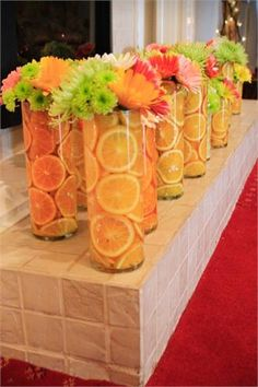 Summer centerpieces orange green yellow with fresh fruit Orlando wedding flowers / www.weddingsbycarlyanes.com