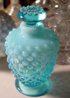 1940's Fenton Aqua Hobnob bottle. I think it's gorgeous, and this color blue bottle has so much translucence and character. This color is hard to find.