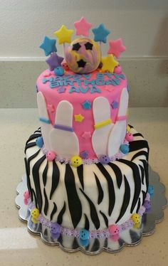 Ava's 8th Birthday bowling cake!  Zebra, bowling pins, stars and bowling balls! Happy birthfay Ava! We hope you and your friends had a blast at your party! Bottom tier: chocolate cake with an Oreo filling,  top tier: white cake with a vanilla funfetti filling.