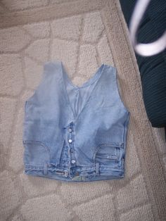 Vest made from men's old jeans...fun and easy....embellish any way you want or ADD more holes..hahaha  go to ebay, i am selling these for $2.99....my user name is ccrwjan  check out my items....